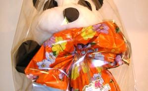 Art.718 uovo cioccolato gr.400 + peluche panda vestito colorato